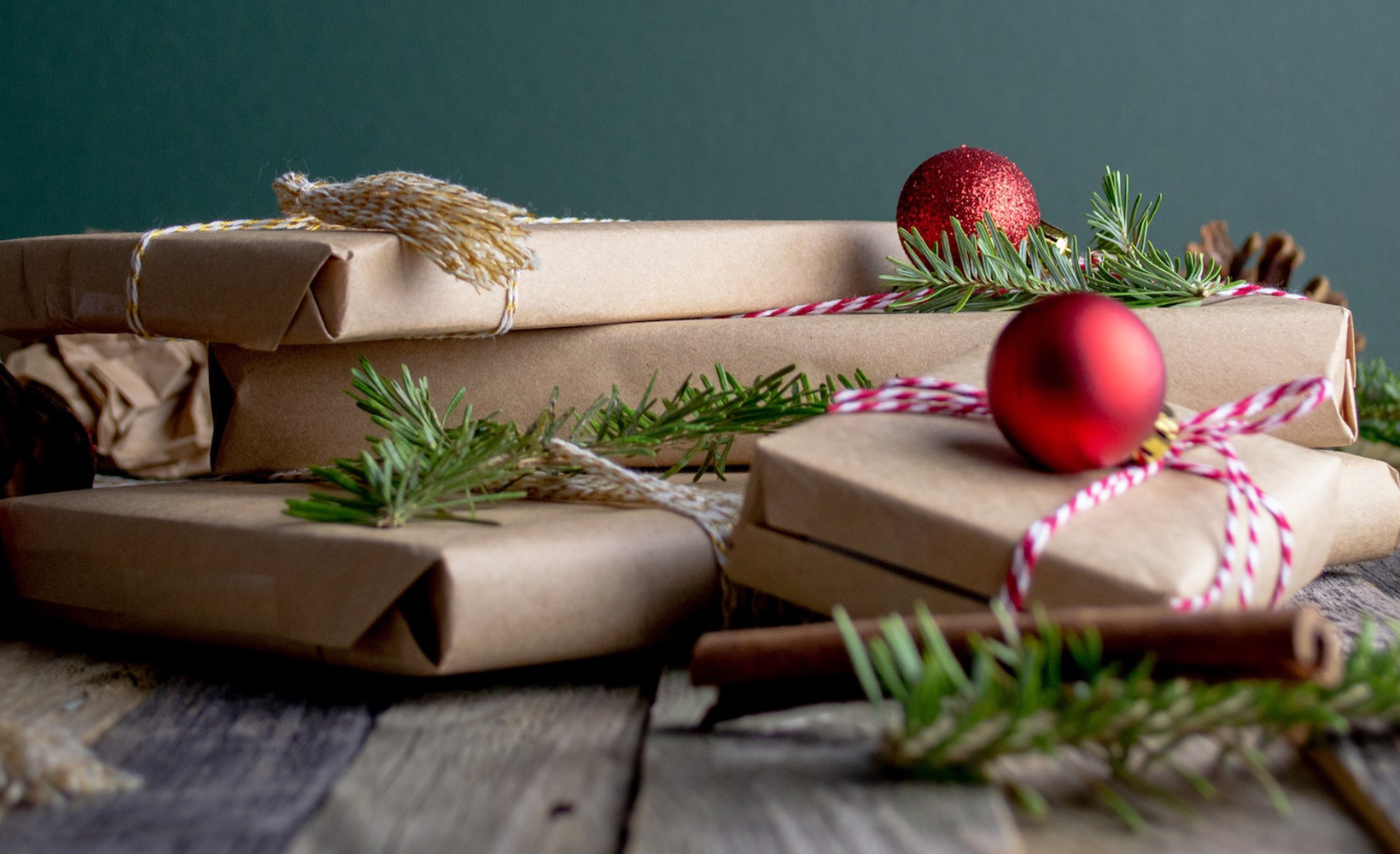 Wrapped Christmas presents on a table representing marketing tips for boosting Christmas sales.
